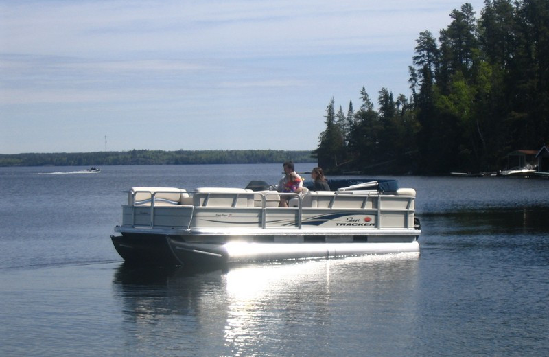 Pontoon boat at Crescent Beach Cottages.