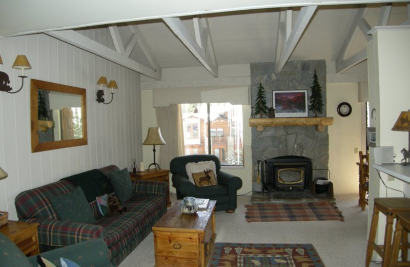 Vacation rental living room and fireplace at Seasons 4 Condominium Rentals.