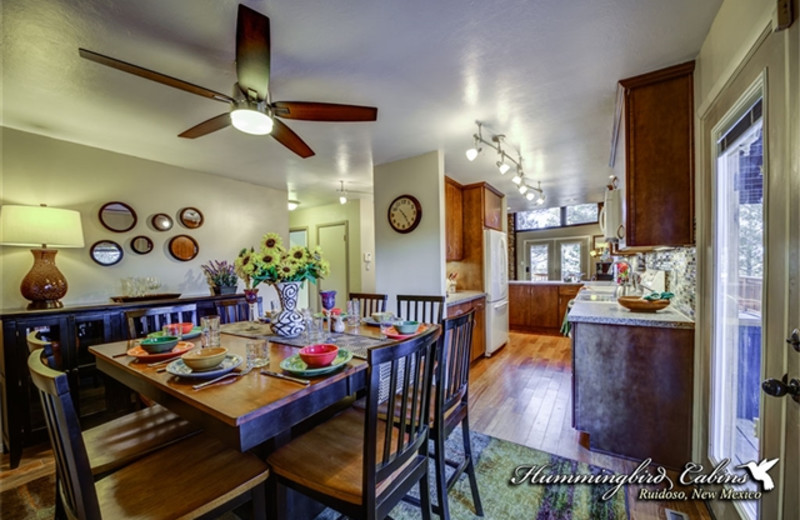 Kitchen and dining area at Hummingbird Cabins - Holly House Vacation Rental