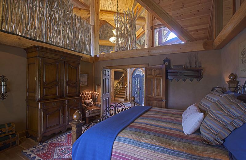 Cabin bedroom at Blue Ridge Vacation Cabins.