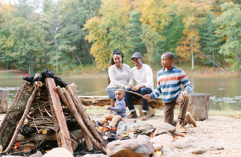 Family by a bonfire at Montfair Resort Farm.