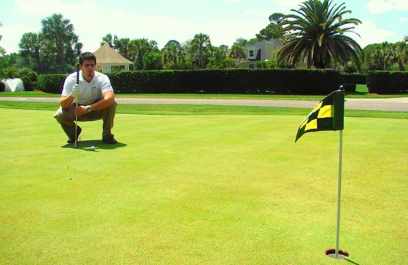 Playing golf at Sea Palms Resort.