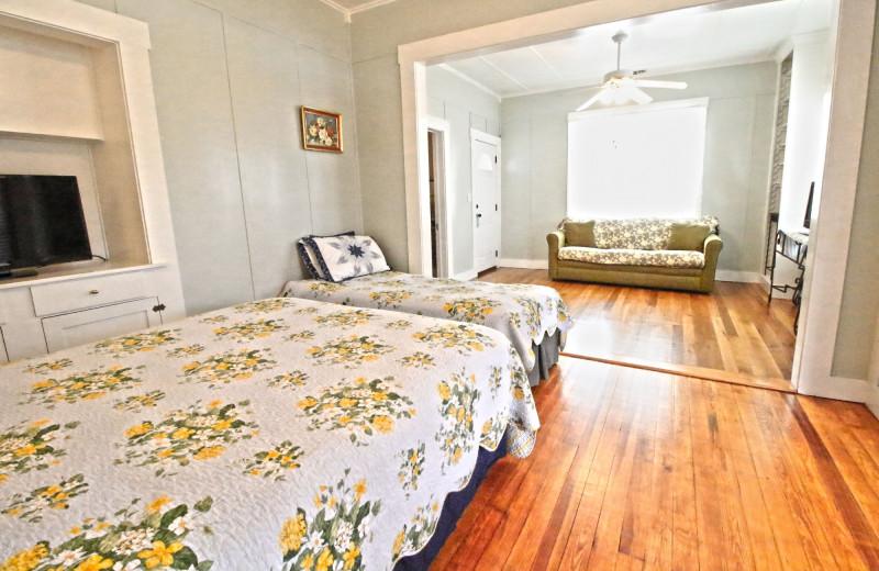 Guest bedroom at Peach Tree Inn & Suites.