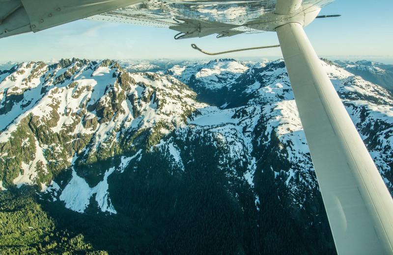Plane ride through mountains at Nootka Wilderness Lodge.