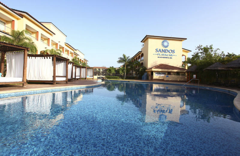 Outdoor pool at Sandos Playacar Beach Resort.