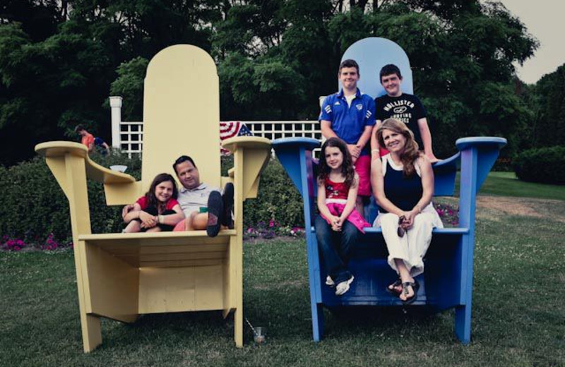 Family in over sized chairs at Basin Harbor Club.