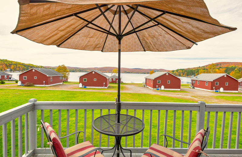 Wafarer rooms with wrought-iron patio furniture on deck at Jackson's Lodge and Log Cabin Village looking west to awesome sunsets.