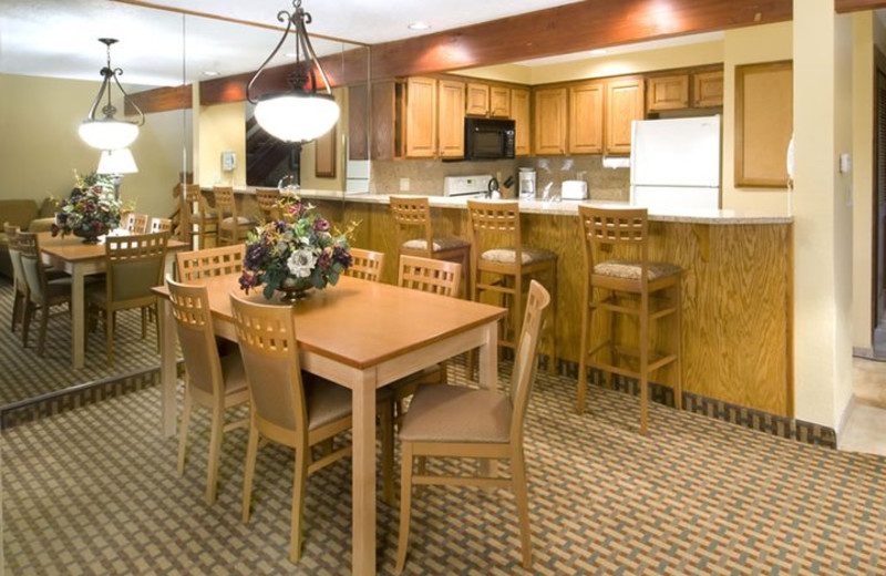 Suite kitchen and dining room at Whispering Woods Resort.