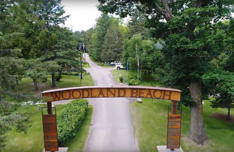 Welcome sign at Woodland Beach Resort.