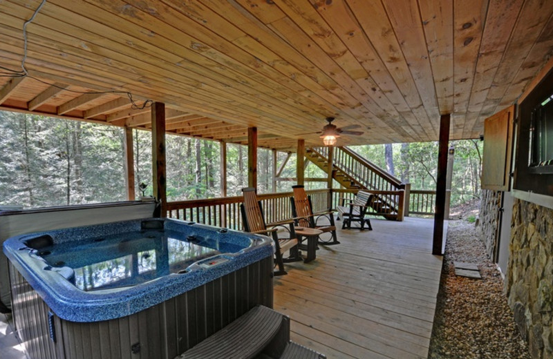 Cabin deck view with jacuzzi at Mountain Top Cabin Rentals.