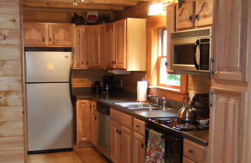 Cabin kitchen at Creeks Crossing Cabins.