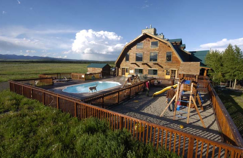 Outdoor pool and children's playground at Bar N Ranch.