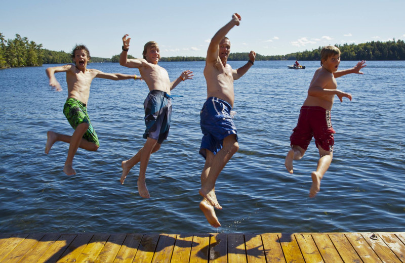 Kids jumping in lake at Severn Lodge.