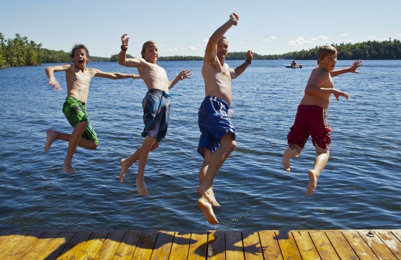 Kids jumping in lake at Severn Lodge.