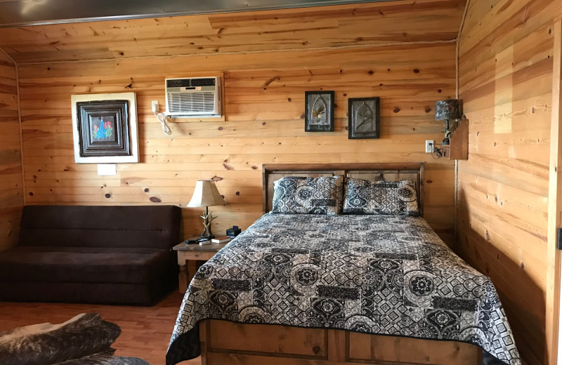 Cabin bed at Walnut Canyon Cabins.