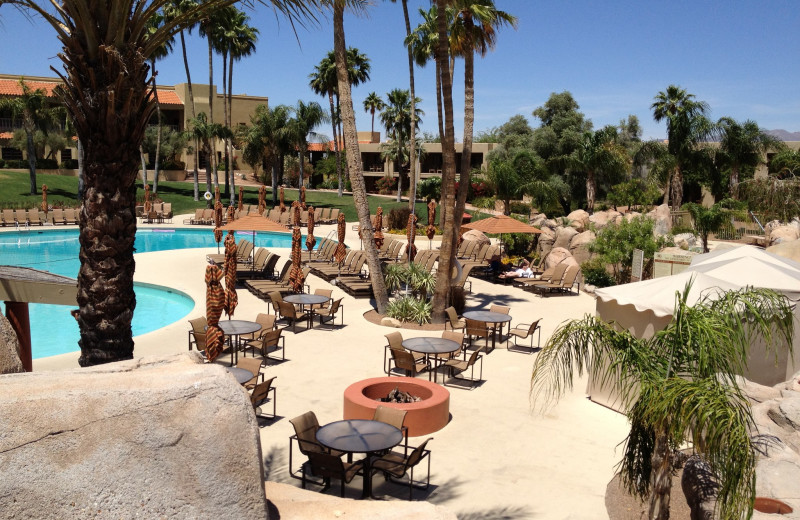 Outdoor pool and lounge chairs at Hilton Tucson El Conquistador Golf & Tennis Resort.