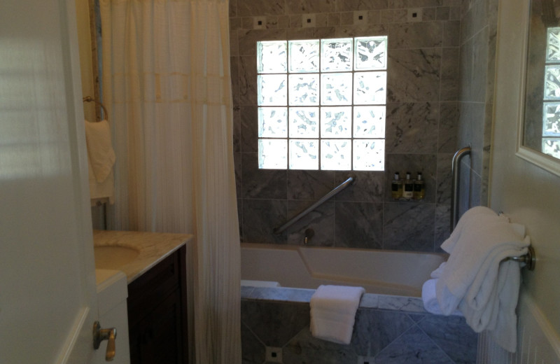 Guest bathroom at Lamp Lighter Inn & Sunset House Suites.