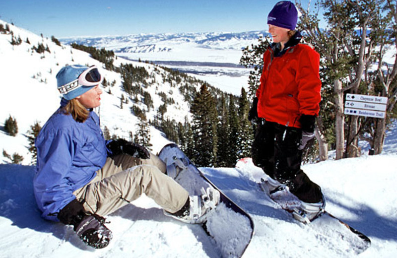 Snowboarding in the mountains near Jackson Hole Lodge.