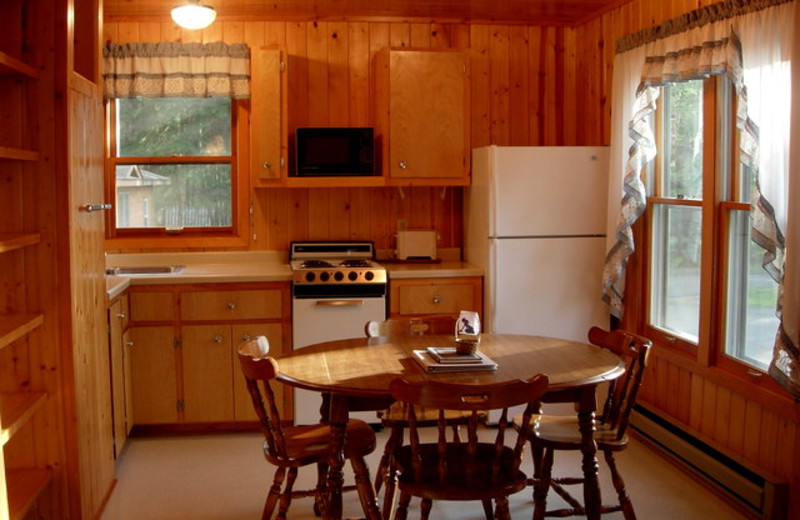Cabin dinning and kitchen area at Black Pine Beach Resort.