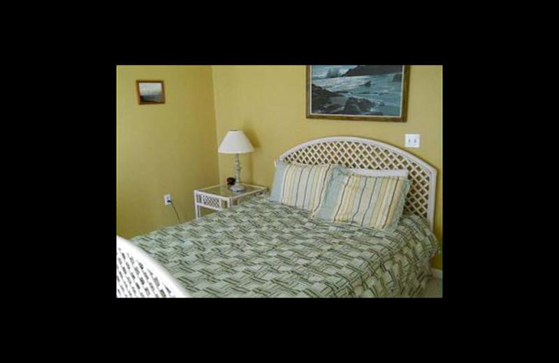 Rental bedroom at Paradise Vacation Rentals.