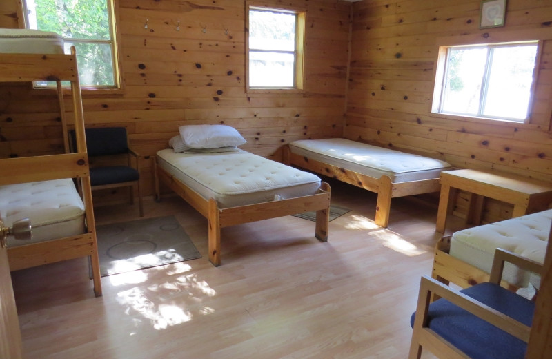 Cabin bedroom at Clark's Resorts & Outposts.