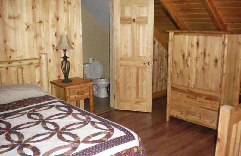 Cabin bedroom at Harman's Luxury Log Cabins.