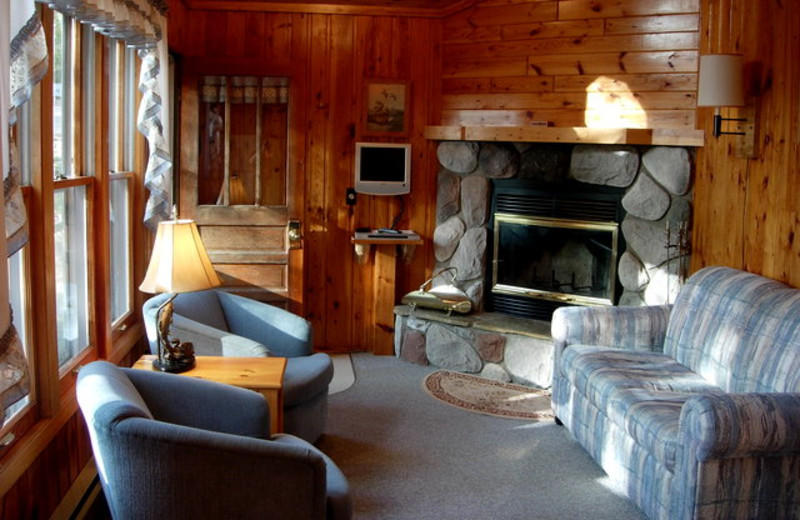 Cabin fireplace living room at Black Pine Beach Resort.