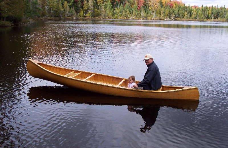 Canoeing on Eagle Lake near Haliburton, Ontario at All-Season Cottage Rentals.