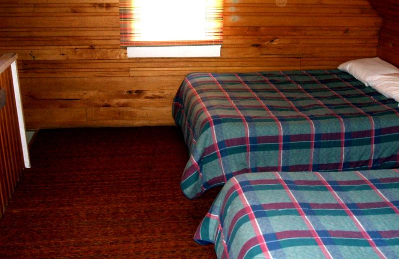 Cabin bedroom at Sunset Bay Resort.