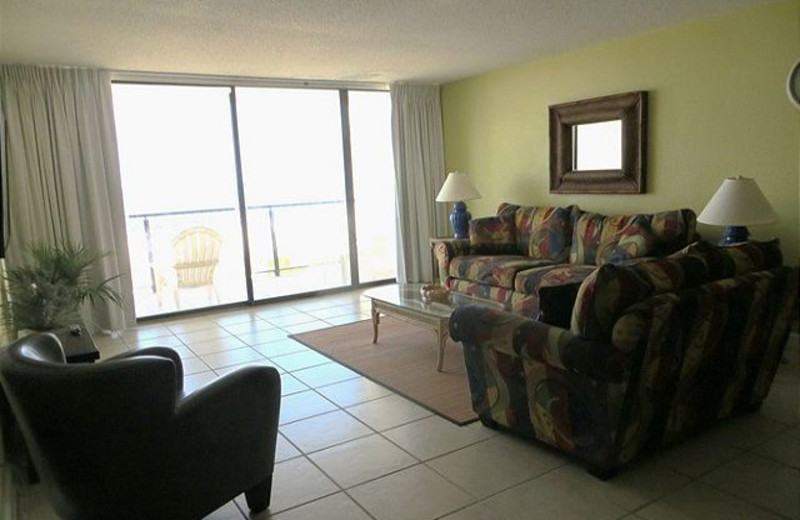 Rental living room at Aqua Vacations and Sales Group.