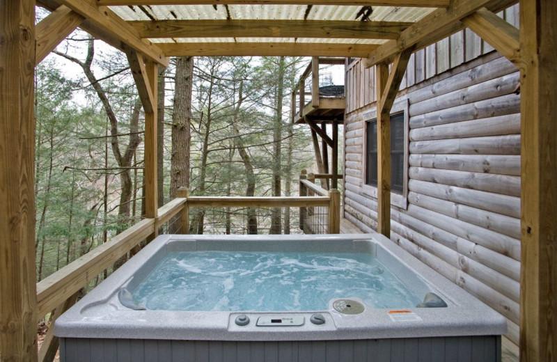 Rental hot tub at Dogwood Cabins LLC.