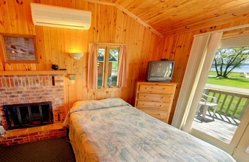 Cabin bedroom at Hiawatha Beach Resort.