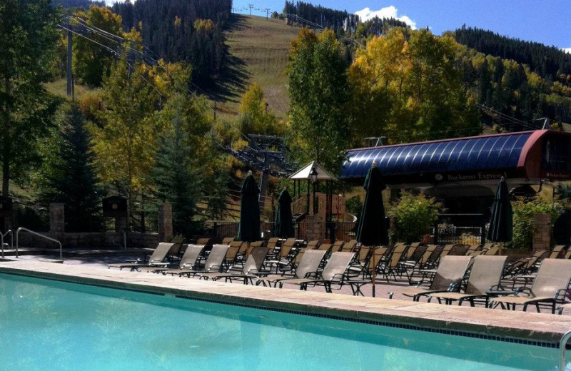 Relax by the pool at East West Resorts Beaver Creek.