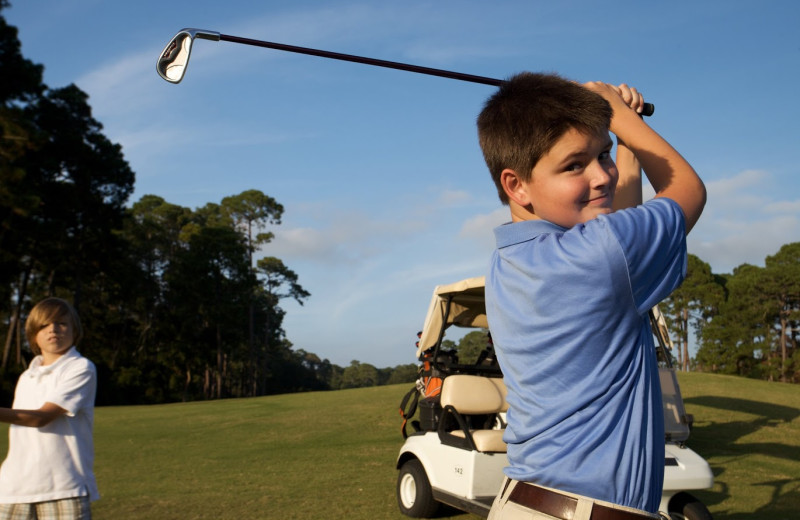 Playing golf at Hampton Inn & Suites Jekyll Island.
