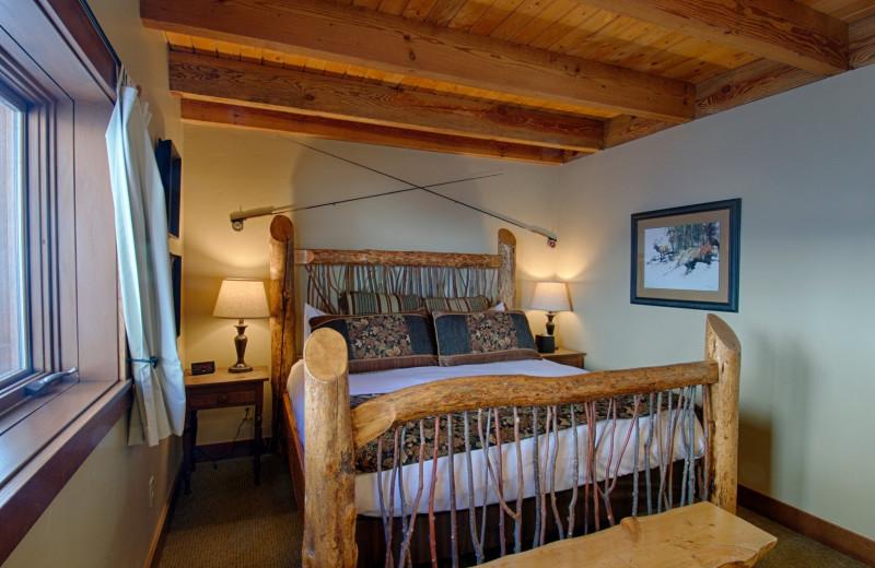 Cabin bedroom at Vista Verde Ranch.