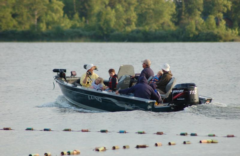 Family boating at Bear Paw Resort.