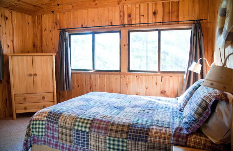 Cabin bedroom at Campfire Bay Resort.