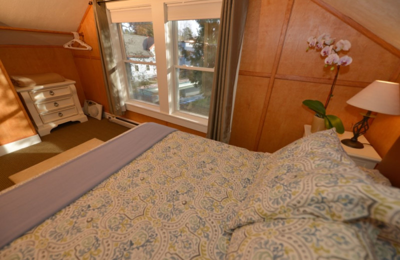 Cottage bedroom at Placid Bay Inn.