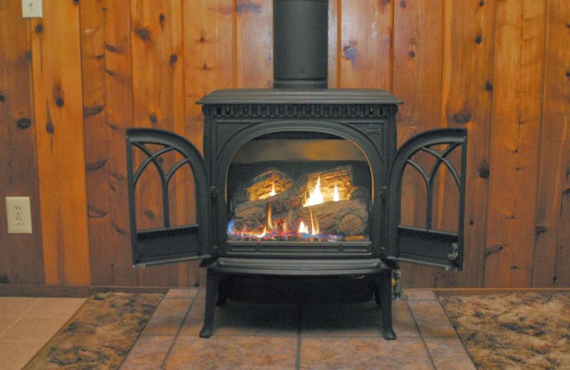 Cabin fireplace at Tsasdi Resort.