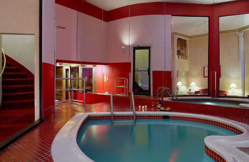 Heated heart-shaped tub in the Roman Tower suite exclusively at Pocono Palace Resort.