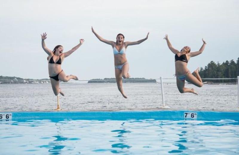 Kids jumping in pool at Linekin Bay Resort.