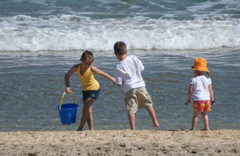 Kids on beach at Beach Vacation Rentals.
