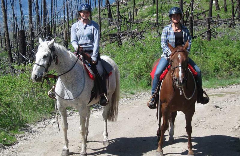Horseback riding at Myra Canyon.