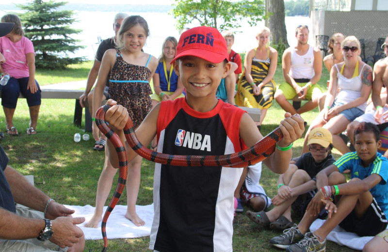 Boy holding snake at Fern Resort.