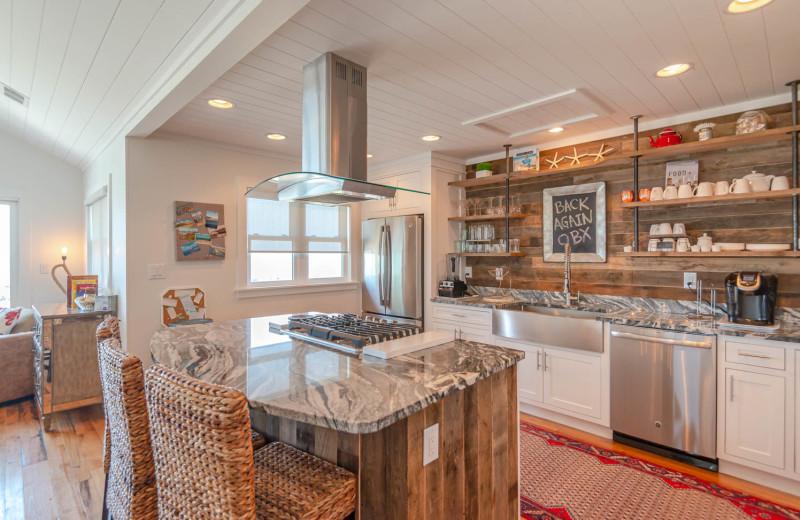 Rental kitchen at Joe Lamb Jr. & Associates Vacation Rentals.