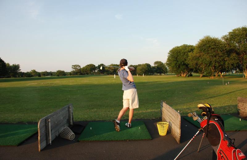 Playing golf near Southampton Inn.