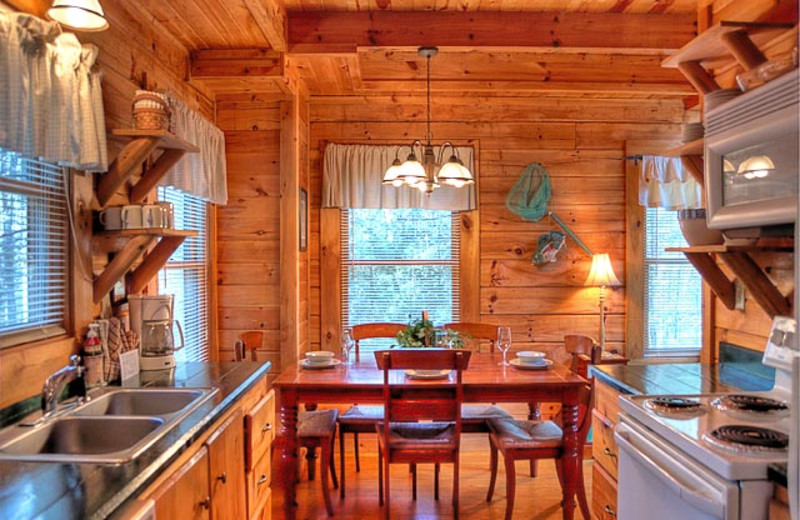 Cabin dining and kitchen at American Mountain Rentals.