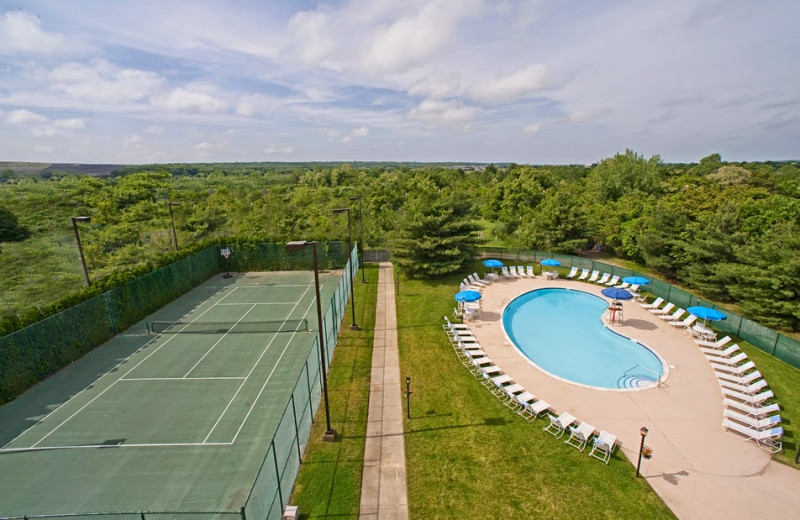 Outdoor pool and tennis court at Hilton-Long Island.