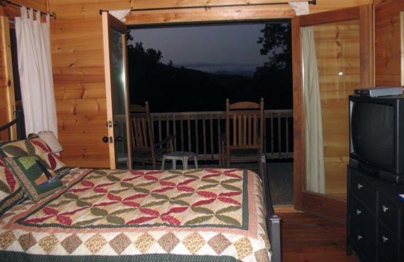 Cabin bedroom at Black Bear Cabin Rentals.