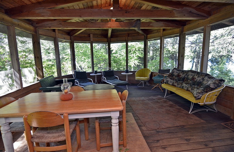 Cabin porch at North Country Vacation Rentals.